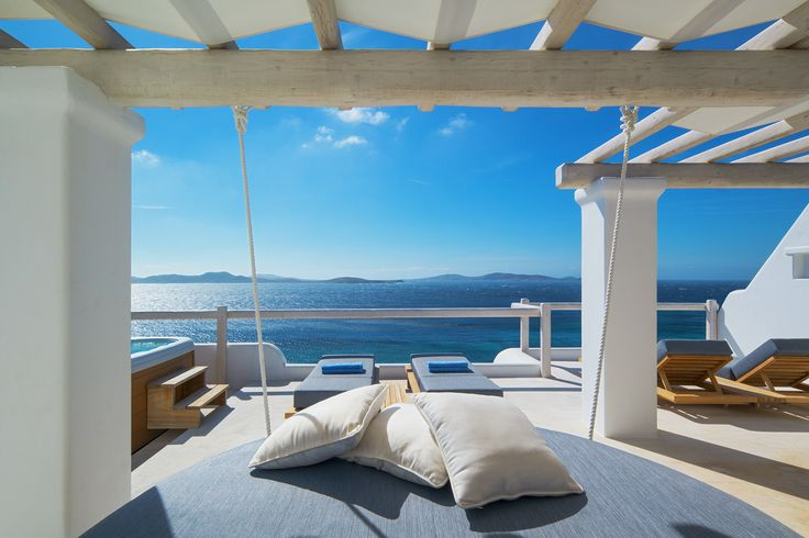 Located on the top floor of Mykonos Grand Hotel & Resort, the Executive Sea View Suite offers magnificent panoramic sea view from the private terrace with sunchairs, an outdoor Jacuzzi, a daybed under a traditional pergola and furniture for alfresco dining experiences.