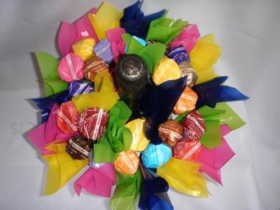 Corporate gift hamper that includes with chocolate truffles in various flavours and a bottle of champagne in the centre. It also comes in a ceramic vase and is available in various colours. Designed to look like a bouquet of flowers, but much tastier!