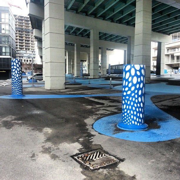 In this memorial, each column represents one member of Toronto's tragically ill-fated Blue Man group.