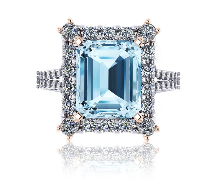 18ct White and rose gold emerald cut 4.20ct Aquamarine with halo of 1.28ct G/Vs diamonds.  #aquamarine #dressring #engagement #celebrationrings #romance #weddings #love