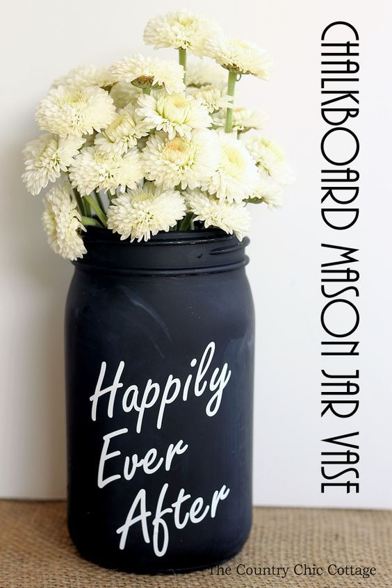Make this chalkboard mason jar vase in just minutes for your wedding! A fun way to add centerpieces to the tables!