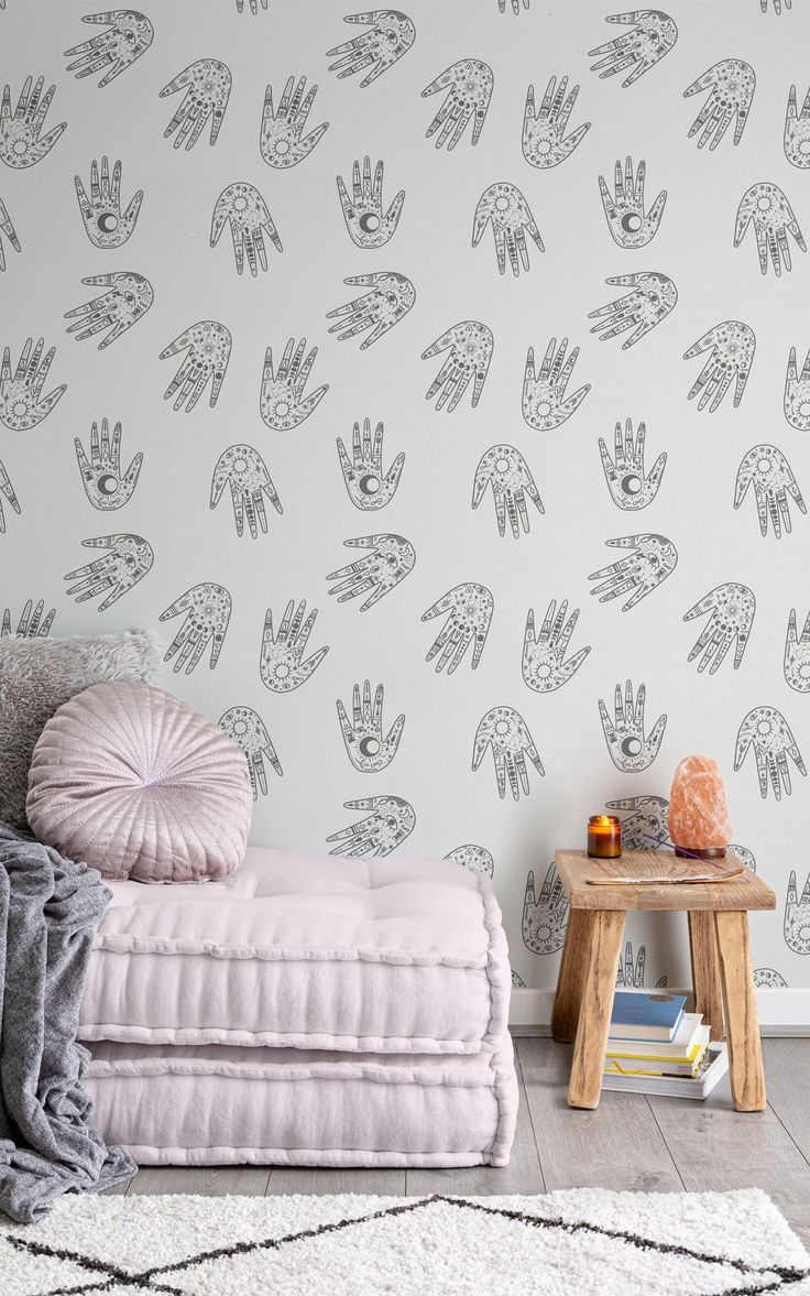 Inspired by the practice of palm reading, this pattern is a mix of modern and ancient design. The wallpaper is filled with symbols of lunar phases, eyes, arrows, snakes, suns, half-moons and more. A great decoration idea for a spiritual meditation corner or daybed space (and don't forget the incense & salt lamps).