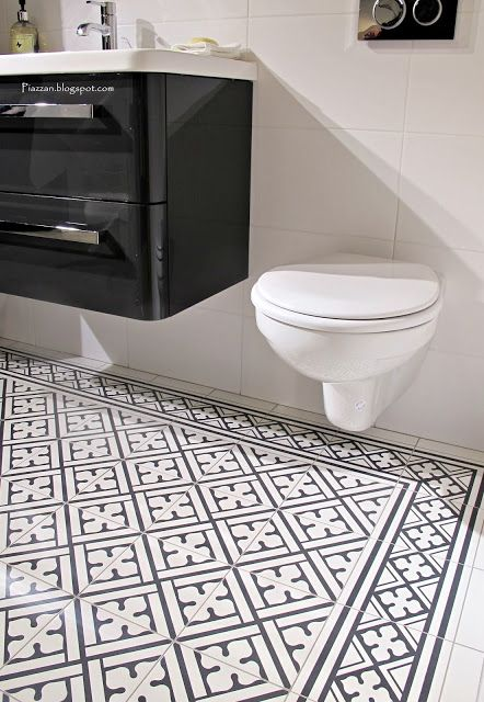 I am not opposed to this type of tiling also wall hanging toilet & sink to save space