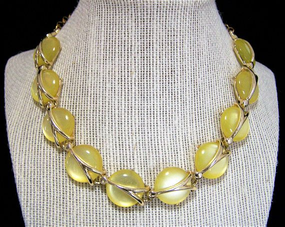 Mid Century lucite moon glow disk necklace Lemon yellow moonglow disks in a gold tone wrapped setting 15.5 inches long, gold tone hook closure Each disk is 3/4 inches diameter Unsigned Matching bracelet is available Very good condition, shows no wear to the finish International buyers welcome, over charges are refunded Priority shipping is optional 42917  Credit cards and Paypal accepted  Any questions, just ask, I want you to be happy with your purchase!  From a smoke free environment