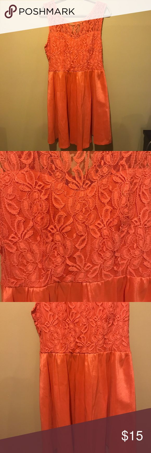 Coral lace dress 👗 Worn once! Dress is in great condition. Coral colored, lace on top and solid on the bottom. Material is 74% polyester, 22% nylon and 4% spandex. La Seala Dresses Wedding