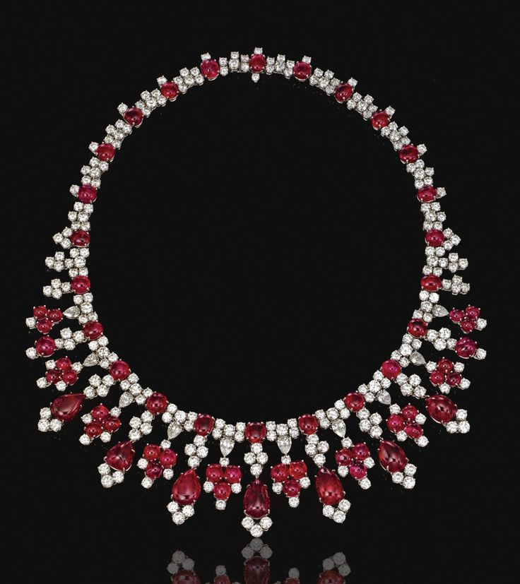 VERY ATTRACTIVE RUBY AND DIAMOND NECKLACE, HARRY WINSTON.  Designed as a series of stylised floral motifs set with pear-shaped and brilliant-cut  diamonds alternating with cabochon rubies, suspending at the front a graduated fringe of pear-shaped cabochon rubies, mounted in platinum,  maker's marks, case.