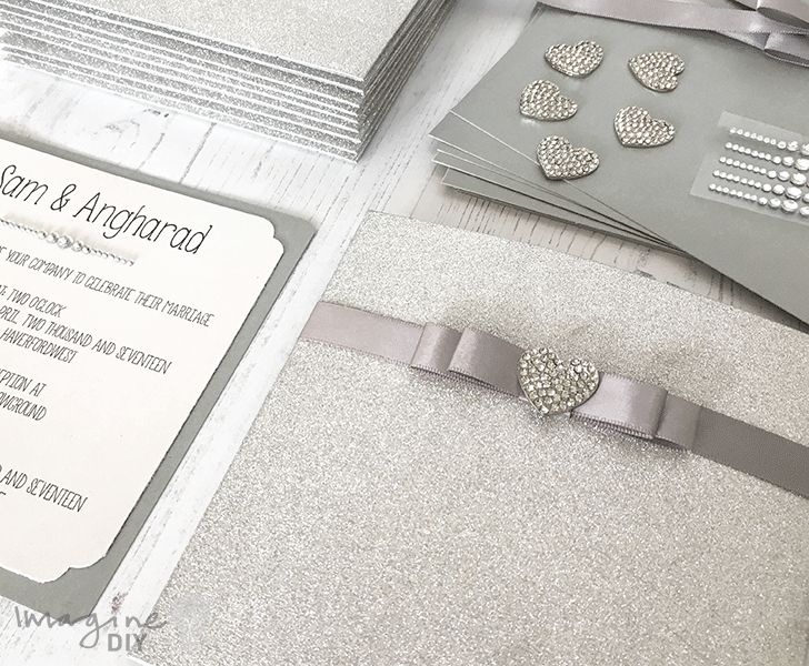 DIY wedding invitation. Silver glitter invitation with crystal heart embellishment. DIY wedding stationery supplies from www.imaginediy.co.uk #silverweddingidea #diywedding #diyweddinginvitation #glitterinvitation #glitterwedding #diyweddingideas #diyweddinginvite #makeyourownwedding #imaginediy #heartinvitation