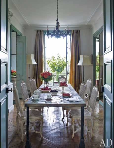 A Light Filled Dining Room Featuring Vintage Chairs And Curtains Made Of Silk Sourced