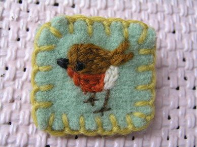 Just so cute!! Little hand-embroidered robin on a tiny bit of fabric.