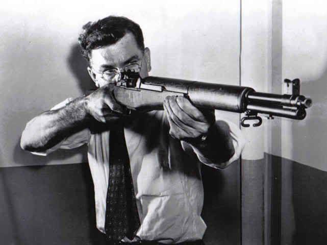 Canadian-American firearm designer John Garand and his M1 Rifle.