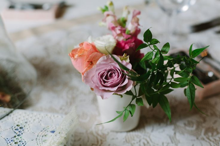Soft pastel arrangement in locally made vase Roses, greenery, snap dragons by www.ecochicweddings.co.za