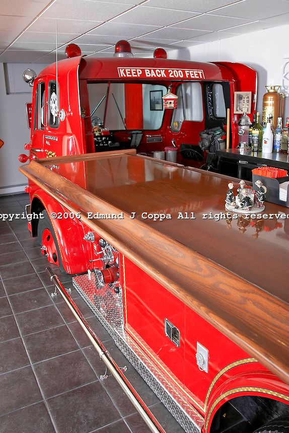 Chris Steel Fire truck bar.After 5 years and 15 thousand dollars Chris Steel made his dream come true. He bought a 1963 Fire truck from a farmer on the east end of Long Island and converted it into his own home bar. The Fire truck was cut up and re-welded , painted and put back together in his basement.