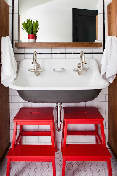 (Inspiration) Foamandbubbles.com: These cute red stools add charm to this industrial-inspired bathroom.