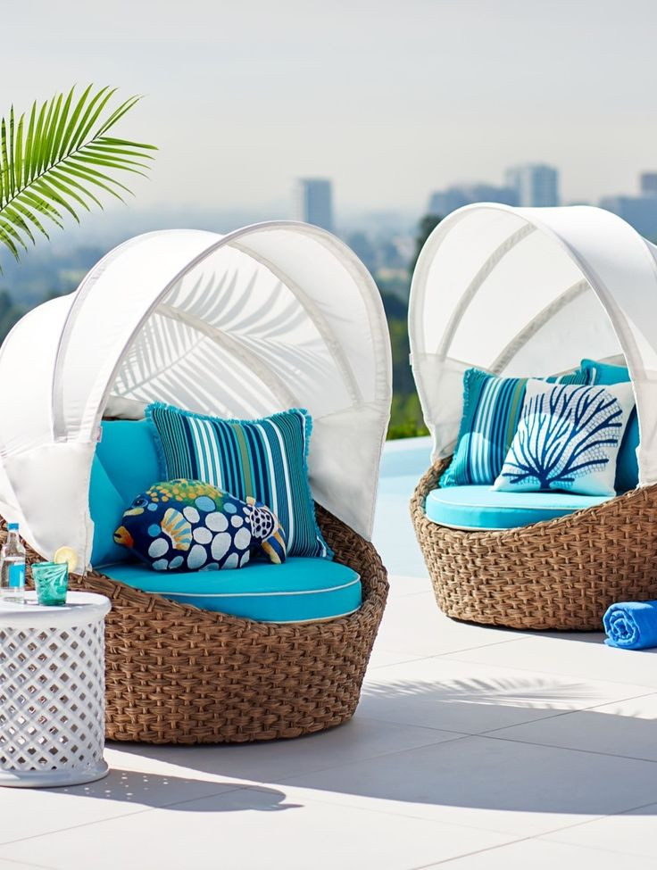 Transform your outdoor space into a tropical port-of-call with our island-inspired Montego Swivel Chair. | Frontgate: Live Beautifully Outdoors