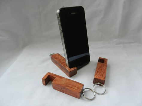 inotch 1 is a compact wooden phone stand for iPhone 4/5 and other compatible smartphones that are 9-12mm thick. It is made from responsibly sourced African Bubinga which is very hard and durable. It measures 61mm long and has a 20mm keyring loop. You will receive a very similar keyring to the ones pictured.