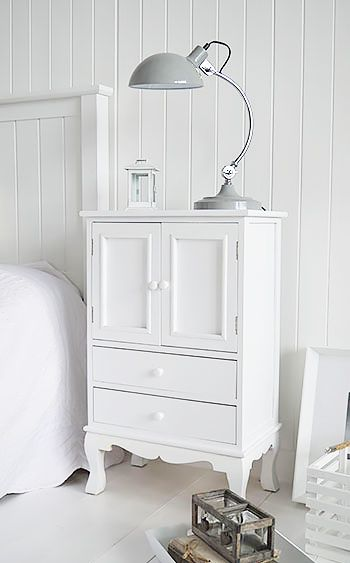 white storage furniture and lamp table for bedside table