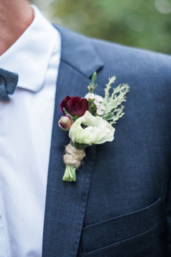 anemone boutonniere - photo by Tara Bielecki Photography http://ruffledblog.com/fall-harvest-friendsgiving-wedding