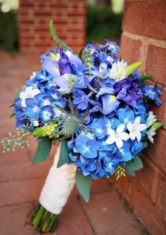 blue iris and hydrangea with seeded eucalyptus / orlandoweddingflowers/ www.callaraesfloralevents.com