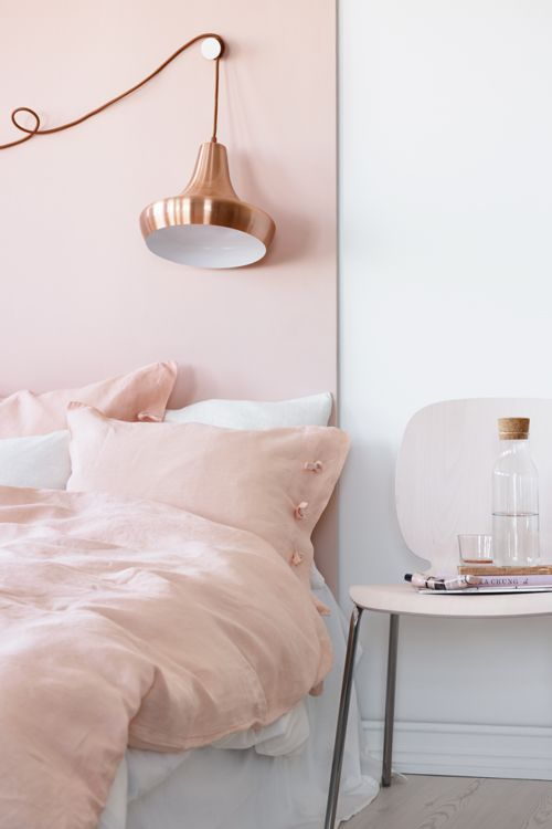 If you're as in love with one of Pantone's Color of the Year, Rose Quartz, as we are, then you've already been dreaming of ways to introduce it into your home. Worried that this shade only makes sense in a kids' room? These chic interiors will have you whipping out your paint roller in no time.