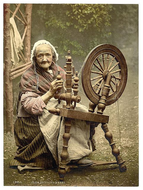 Irish spinner and spinning wheel. County Galway, Ireland[between ca. 1890 and ca. 1900].