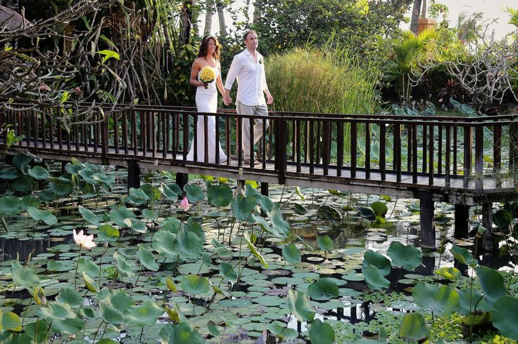 Wedding photography by the Lotus Pond at Hotel Tugu Bali .
