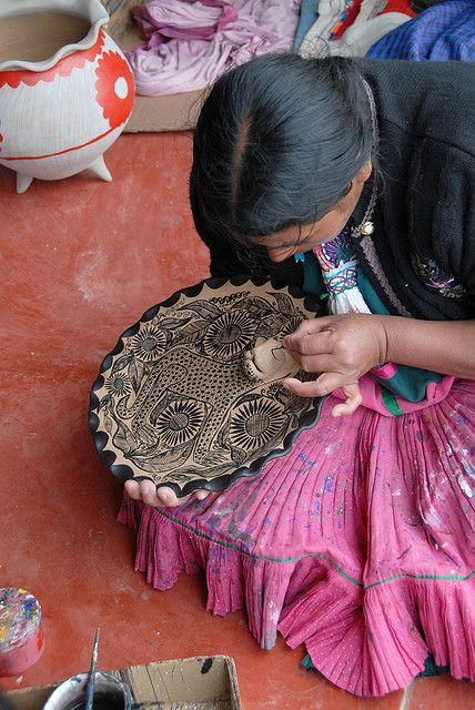 Maya Potter Painting Detail on a 3 Dimensional Jaguar Plate in Amatenango, Chiapas, Mexico  los mayan painta los ollas.