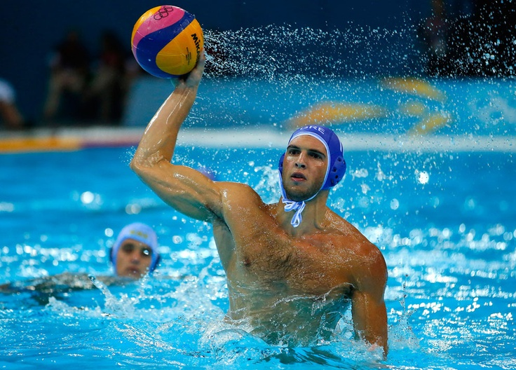Greece's Ioannis Fountoulis controls the ball during the men's preliminary round Group A water polo match against Kazakhstan at the London 2012 Olympic Game