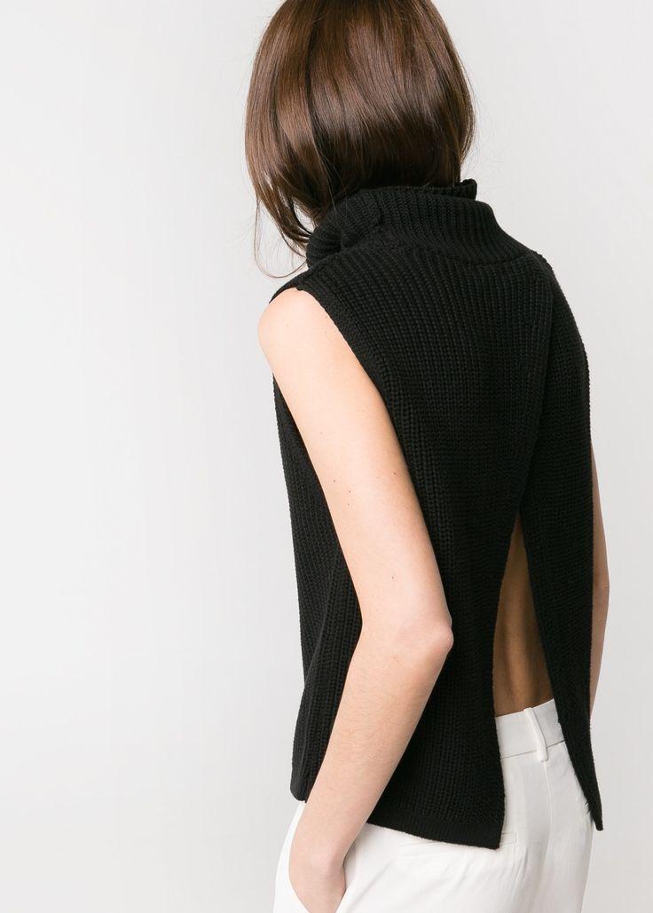 Chic black split back top; contemporary fashion details