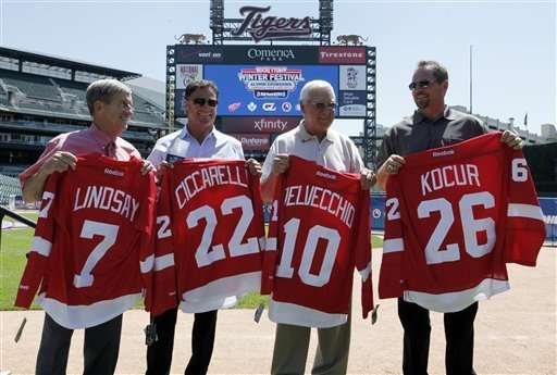 Former Detroit Red Wings players, from left,Ted Linsday,Dino Ciccarelli, Alex Delvecchio and Joe Kocur  hold their jerseys during a news conference at Comerica Park in Detroit, Wednesday, July 11, 2012, announcing the preliminary rosters for the Toronto Maple Leafs-Detroit Red Wings Alumni Showdown hockey game on Dec. 31, 2012.  (AP Photo/Paul Sancya)