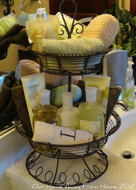 <3 Tier basket in the bathroom - guest bath to fill with extra toiletries and towels.  Fill it with accent colors and it becomes a decorative display in the bathroom...or i could store all my crap here!