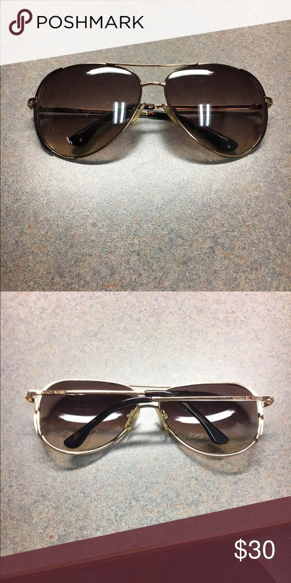 Michael Kira Aviator Sunglasses Brown and gold Aviator sunglasses. One side has a loose hinge but still wearable and great condition. Michael Kors Accessories Glasses
