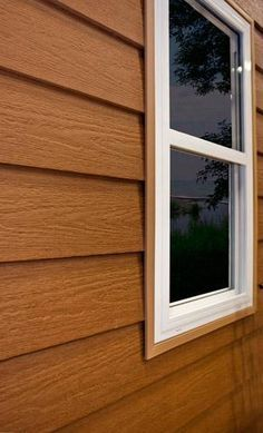 Vinyl siding that looks like cedar! The look of a log home without upkeep and cost. :)