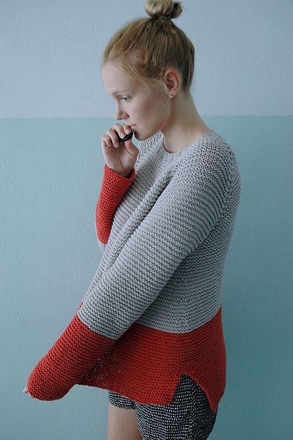 This beautifully easy, seamless raglan is a cozy layering piece. Slightly oversized fit, knit in garter stitch with split side seam and colorblocking detail. Knit in soft cotton blend, but would be perfect in a soft wool for winter.