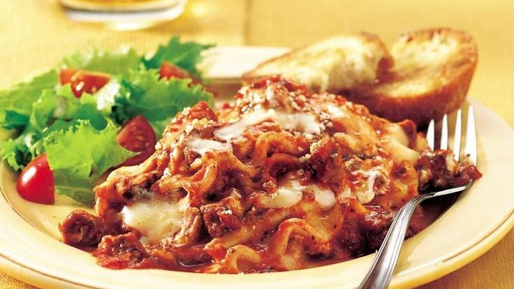 Add something cheesy to your family's Italian dinner! Discover the convenient slow-cooker way to make a ground beef lasagna — so delicious and so easy!