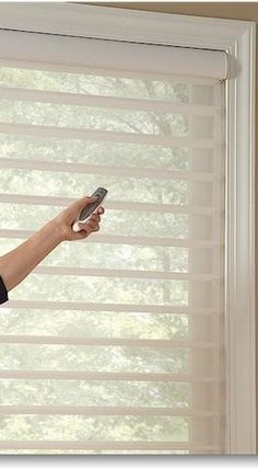 Hunter Douglas Silhouette Shades with automation. Choose the blackout option for bedrooms. Available through Ferris Blinds Shades & Shutters, Centreville, VA