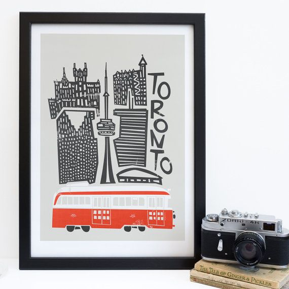 A bold and fun Toronto, Canada print.  A vibrant and multicultural city, Toronto is buzzing with life and excitement. This cityscape print highlights the famous streetcars and many of Torontos key buildings, including the CN tower, Scotia Plaza, the Rogers Centre and more. It makes a wonderful gift for anyone who has been able to call Toronto home.  Check out our other city prints here: http://etsy.me/1f5OlvU  Item Details • This listing is for one unframed print. • Printed wit...