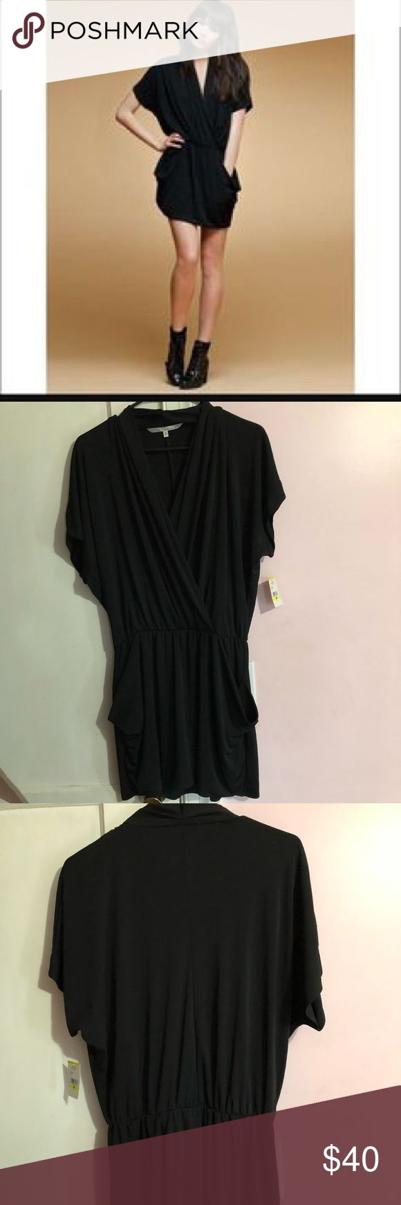 Rachel Roy 24 Hr Dress Rachel Roy 24 Hr dress is new with tags. Features a plunging neckline, flattering draping, and POCKETS! Size medium, stretchy fabric could also fit a large. Rachel Roy Dresses