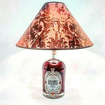 Special table lamp for drinkers. Lamp shade in prestigious Rubelli fabric GRITTI on coral color. Base with special italian herbs liqueur.