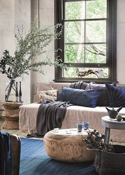 Decorate with flowers - Adorn your side table with oversized branches to create an earthy focal point with a hint of drama. Home Beautiful