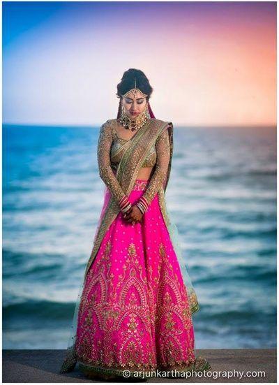 mint blouse, rani pink lehenga, gold embroidery