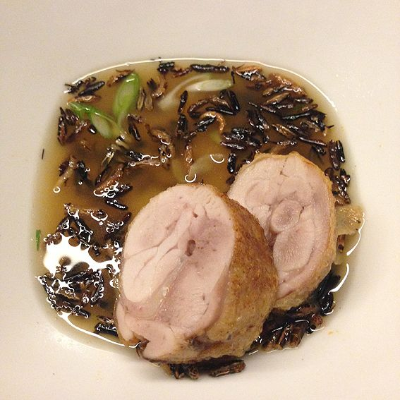 Chicken poached with ginger broth and wild rice.