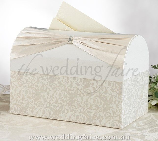 This elegant card box is covered in ivory satin.  The top portion of the front side has a ivory sash with rhinestone ornament.  The lower portion of the front and sides is silk-screened with a ivory leaf and vine pattern.  Size: 30cm wide x 20cm tall x 20cm deep.