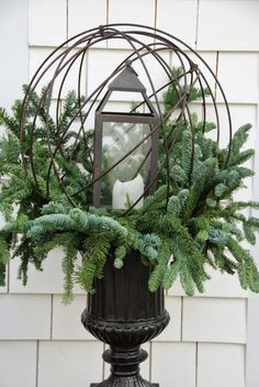 Pretty outdoor Christmas arrangement!                                                                                                                                                                                 More