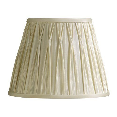 Laura Ashley SFP610 Classic 10.5-Inch Pinched Pleat Shade, Cream by Laura Ashley. $30.60. From the Manufacturer                Founded in 1953, Laura Ashley has become a quintessential English brand, synonymous with quality, creativity, and individuality. Laura Ashley products are recognized worldwide for their colorful patterns and iconic floral prints. This cream Laura Ashley lamp shade is made of faux silk, and will be a vibrant addition to any room.                    ...