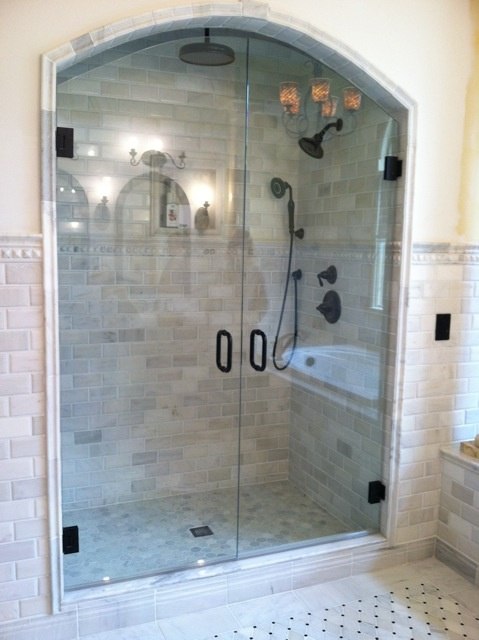 Double Arched Doors Creates A Regal Frameless Shower Glass