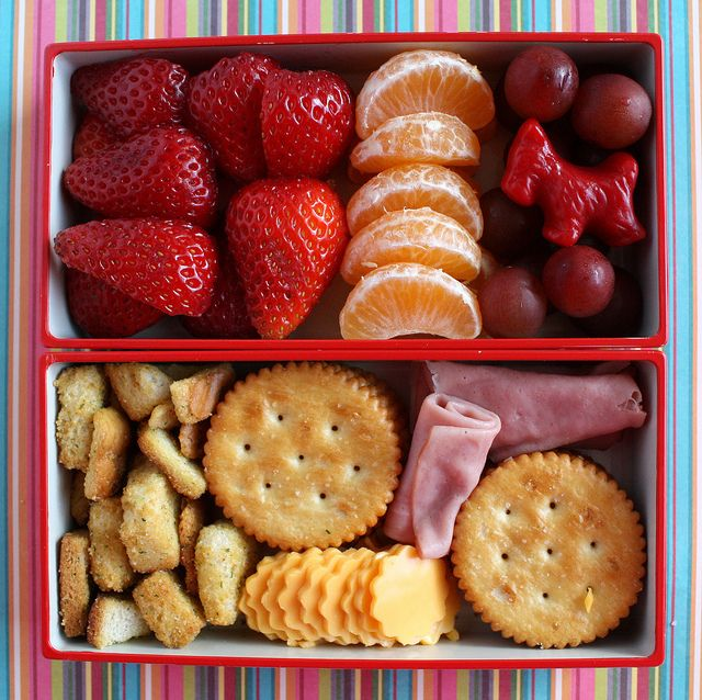Cheese Lunch Meat Crackers Strawberries Orange Slices And Grapes