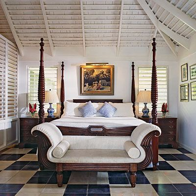 British Colonial style bed and sofa in this romantic bedroom in Jamaica.