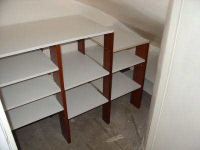 Under stair shelving diy pinterest stairs storage for Building shelves under stairs