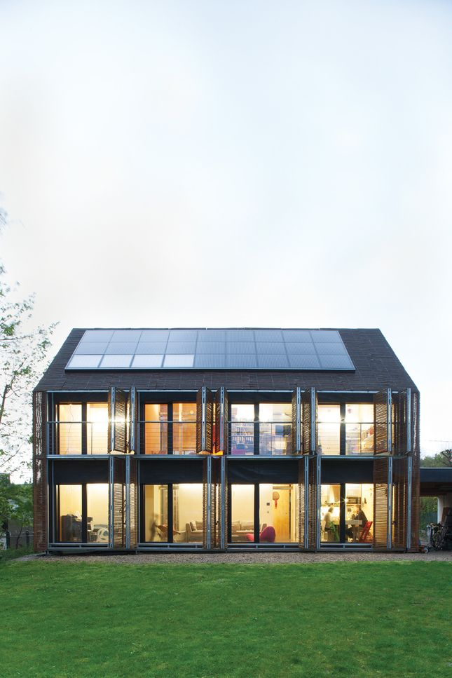 With the roof angled at 43 degrees, the architects lined the southern slant of the house with solar panels to collect as many rays as possible. With the western facing house this may make sense. Photo by Nicholas Calcott.    Read more: http://www.dwell.com/slideshows/passive-prog