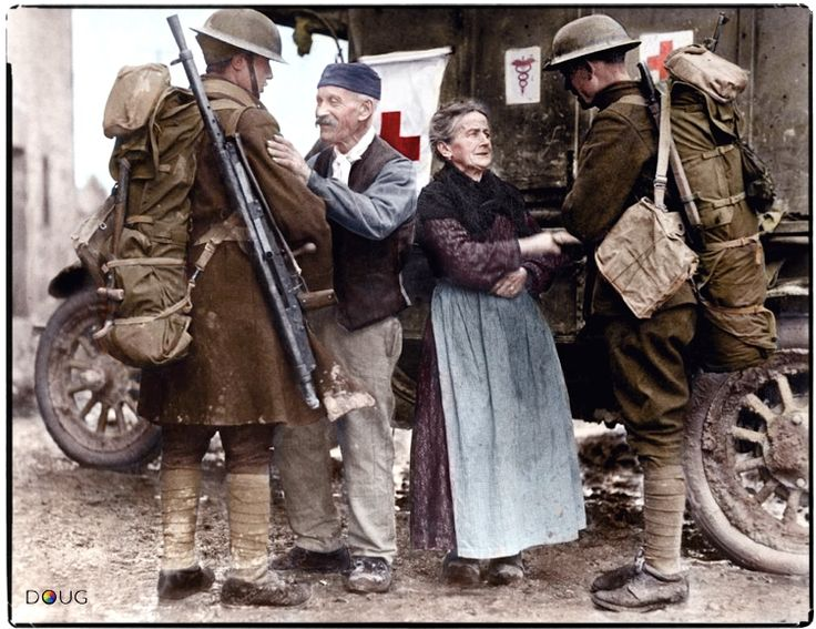 M. and Mme. Baloux of Brieulles-sur-Bar in the Ardennes welcome two US soldiers from the 308th and 166th Inf. Regts. during the American Forces liberation of their town on the 6th November 1918.